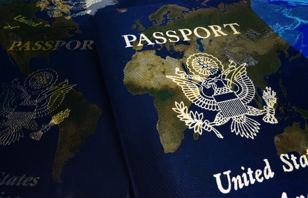United States passports superimposed over a world map