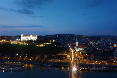 View of Bratislava Slovakia at dusk with the Danube River in the foreground