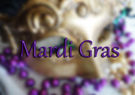 Purple Mardi Gras text over a masquerade mask and beads