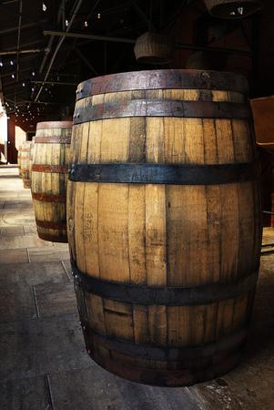 Old oak barrels in a distillery warehouse
