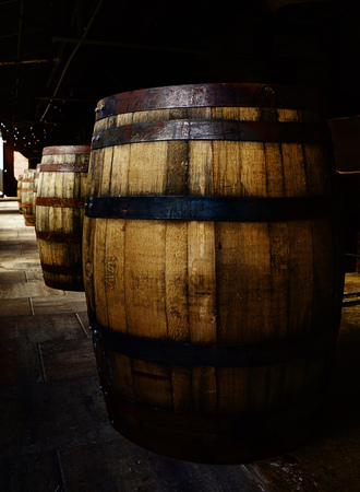 Old oak barrels in a craft distillery warehouse Reklamní fotografie