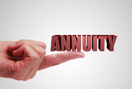 Annuity text balancing on a finger Stock Photo