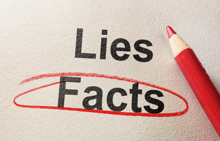 Facts circled in red pencil below Lies 版權商用圖片