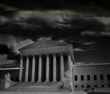 The US Supreme Court in Washington DC with dark storm clouds 스톡 콘텐츠