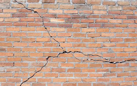 Brick building with cracked foundation Stock fotó