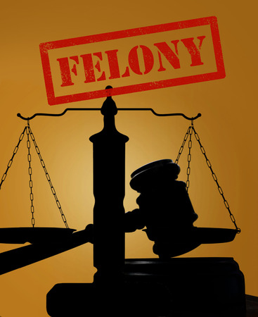 Court gavel and scales of justice silhouette with Felony text