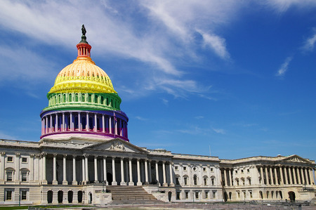 The United States capitol building in Washington DC with LGBTQ colored dome