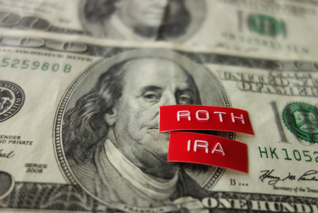 Roth IRA label on a hundred dollar bill Stock Photo - 115064479