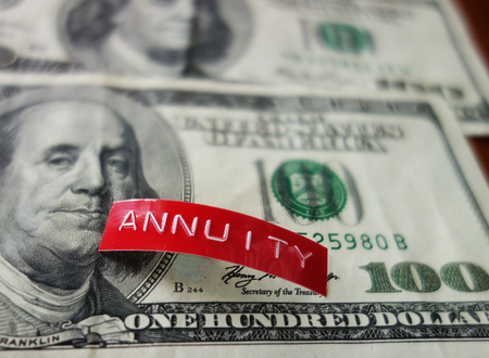 Red Annuity label on a hundred dollar bill Stock Photo