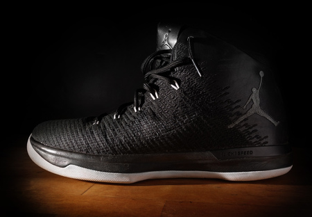 RALEIGH,NCUSA - 12-13-2018: Nike Air Jordan FlightSpeed basketball sneakers on dark background Editorial