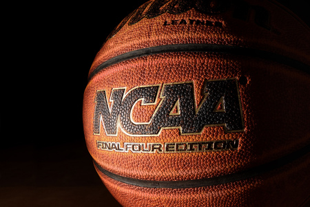 RALEIGH,NCUSA - 12-13-2018: An NCAA Final Four Edition basketball on hardwood with dark background Editorial