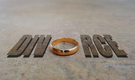 Cracked gold wedding ring spelling Divorce Stock Photo - 118000441