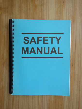 Workplace Safety Manual on a desk