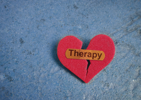 Broken red heart with Therapy bandage
