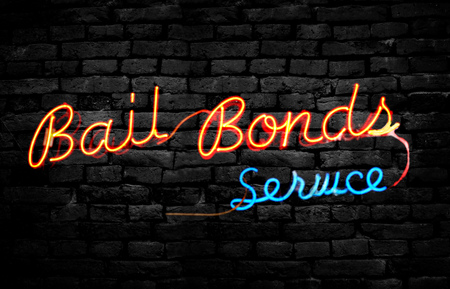 Neon Bail Bonds Service sign on a brick wall 스톡 콘텐츠