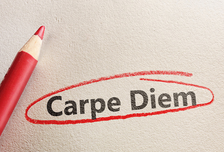 Carpe Diem, Latin for Seize The Day, circled in red pencil                                Stock Photo