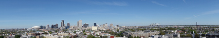 Panoramic view of New Orleans skyline under blue sky