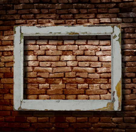 Old wood picture frame and brick wall