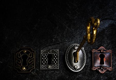 Gold key opening one of four vintage locks