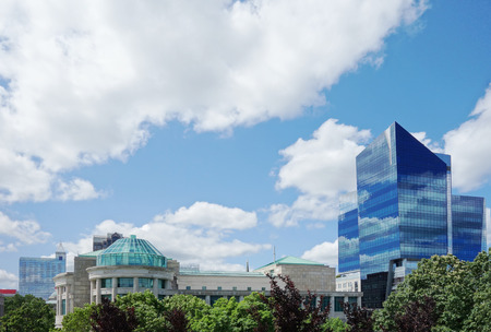 View of downtown Raleigh NC with the green dome of the NC Museum of Natural Sciences in the foreground