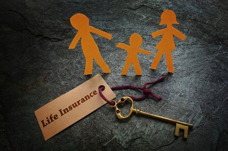 Paper family of three with gold key and Life Insurance tag
