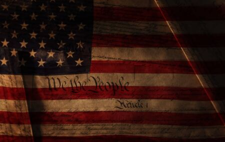 Text of the United States Constitution over the US flag