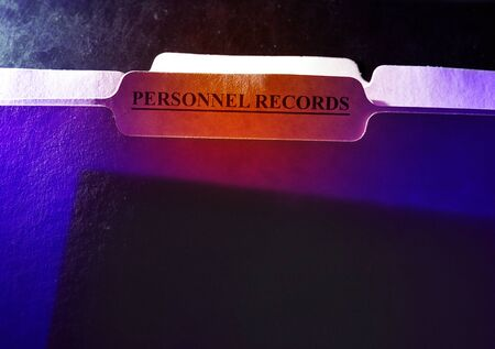 Personnel Records folder with visible document inside -- employee privacy concept