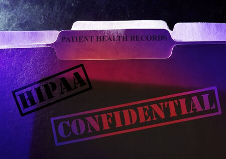 Confidential Patient Health Records folder with HIPAA stamp