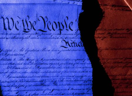 The United States Constitution in red and blue torn in half representing division between Democrats and Republicans 版權商用圖片 - 131495476