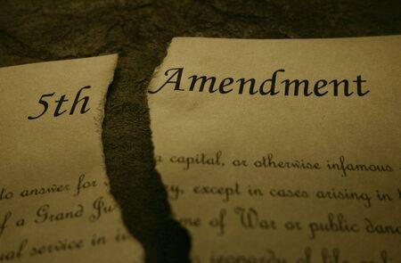 Fifth Amendment of the US Constitution text ripped in half Foto de archivo - 135369690