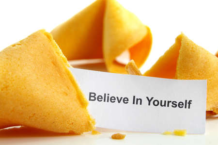 Believe In Yourself fortune cookie, closeup on white