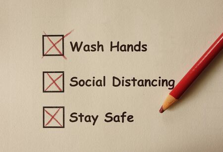 Wash Hands , Social Distancing , Stay Safe text on paper with pencil -- Corona Virus prevention tips Stock Photo