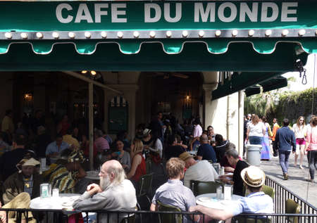 NEW ORLEANS,LA/USA -03-21-2014: People gathered at the famous Cafe Du Monde in New Orleans French Quarter