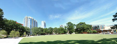 View of downtown Raleigh buildings from Moore Square, a popular public park