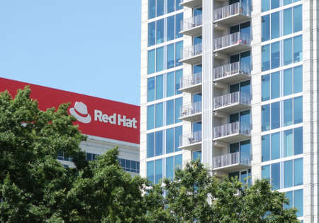RALEIGH,NC/USA - 6-29-2020: The Red Hat headquarters building in downtown Raleigh, NC 新闻类图片