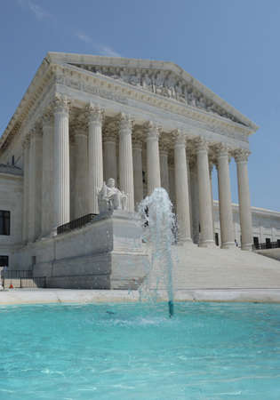 The US Supreme Court building in Washington DC with fountain in the foreground