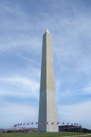The Washington Monument in DC surrounded by American flags
