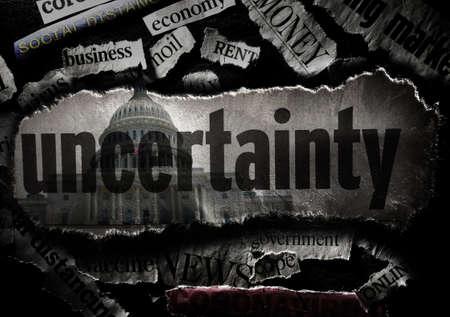 Uncertainty and Coronavirus economy news headlines with US Capitol dome