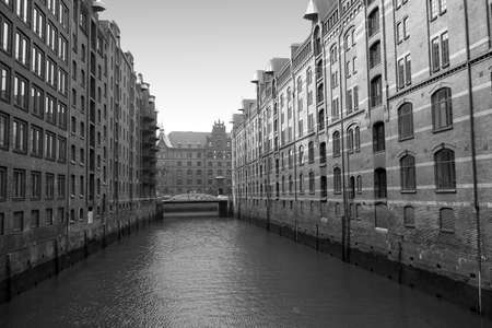 A canal in the Speicherstadt, or warehouse district, in Hamburg Germany 免版税图像