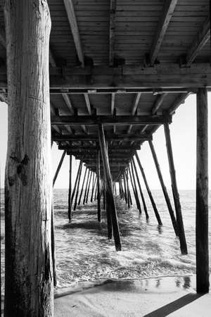 Avalon Pier and beach at the Outer Banks of North Carolina in black and white Stock fotó