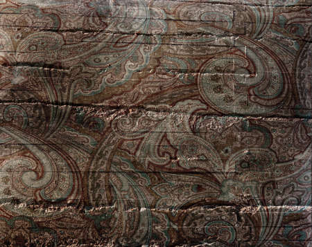 Vintage paisley pattern on distressed textured stone background