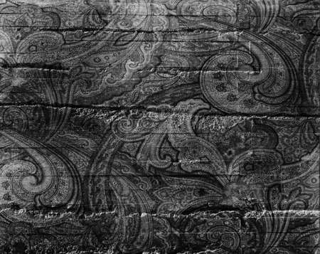Vintage black and white paisley pattern on distressed textured background