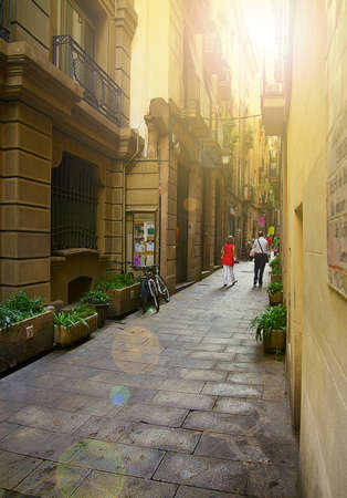 People walking down a quiet pedestrian street in Barcelona Spain