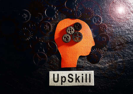 Head and gears with Upskill text on textured background