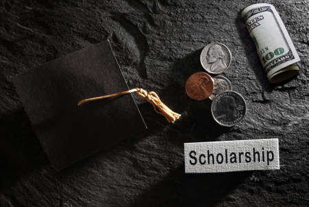 Education graduation cap with Scholarship text and money