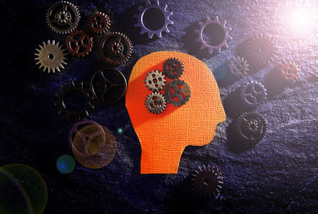 Head figure with gears on textured surface -- science or technology background