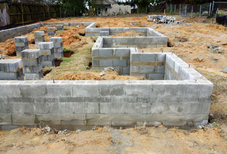 Cinder block foundation being built for new home construction