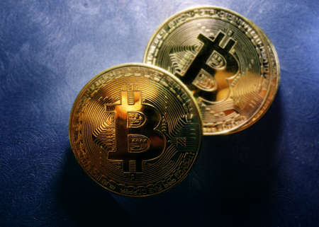Gold bitcoin vitual cryptocurrency on blue