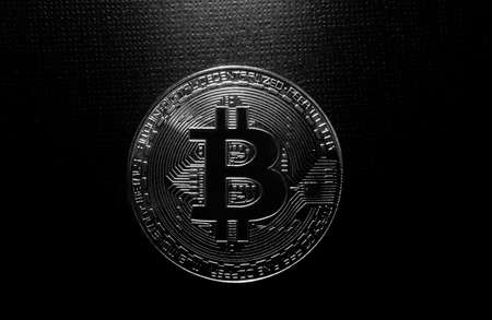 Bitcoin virtual crytocurrency on black background Standard-Bild