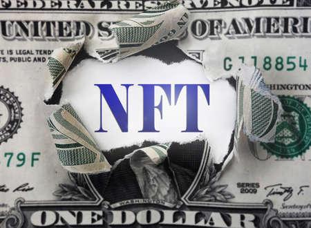 NFT ( Non-Fungible Token -- a blockchain asset) text in a torn dollar bill